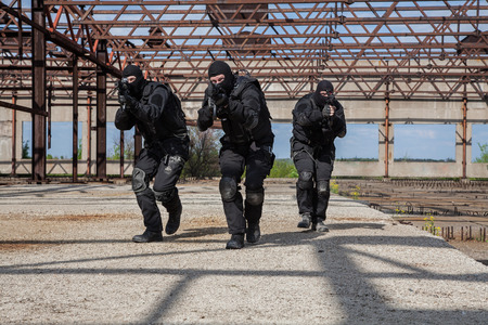 special operations: Special forces operators in black uniform in action
