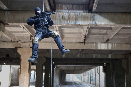 assault forces: Special forces operator during assault rappeling with weapons