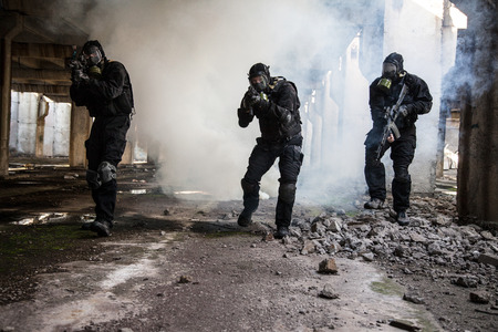police helmet: Special forces operator in black uniform in the smoke