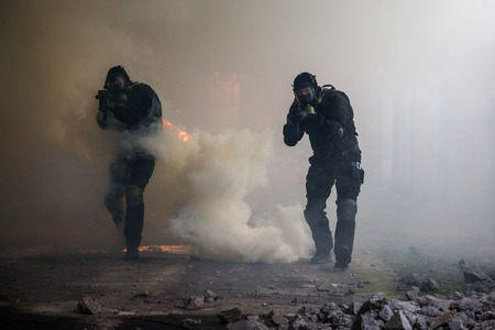 special operations: Special forces operator in black uniform in the smoke