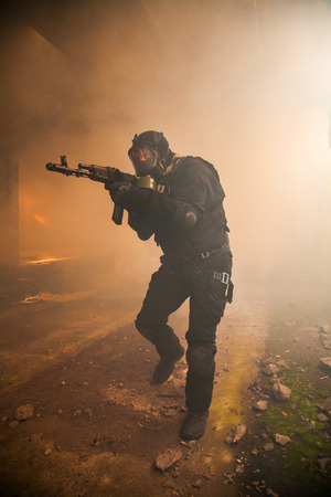 wars: Special forces operator in black uniform in the smoke