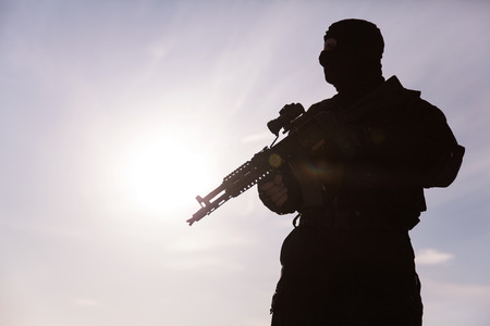 weapon: Silhouette of special forces operators with weapons Stock Photo