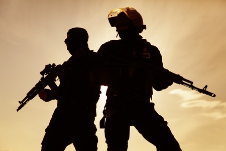 weapons: Silhouette of special forces operators with weapons Stock Photo