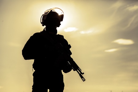 police unit: Silhouette of special forces operators with weapons Stock Photo
