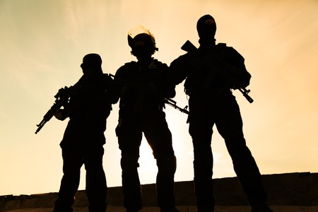 assault forces: Silhouette of special forces operators with weapons Stock Photo