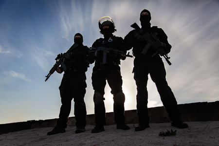 Silhouette of special forces operators with weapons Stok Fotoğraf