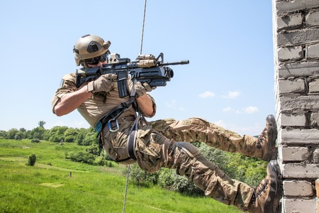 weapons: Soldier during assault rappeling exercises with weapons