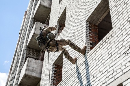 rappeling: Soldier during assault rappeling exercises with weapons