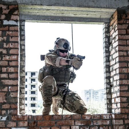 weapon: Soldier during assault rappeling exercises with weapons
