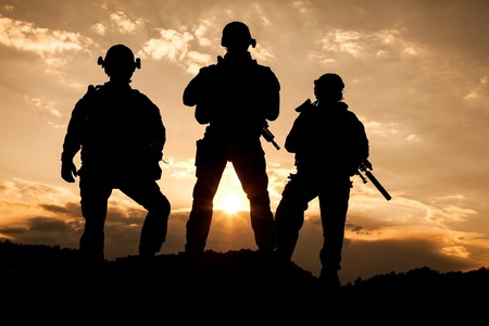military uniform: United States Army rangers on the sunset