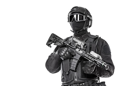 american army: Spec ops police officer SWAT in black uniform and face mask studio shot
