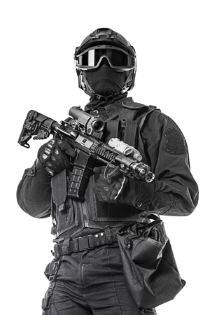 anti war: Spec ops police officer SWAT in black uniform and face mask studio shot