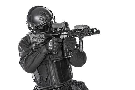 a police officer: Spec ops police officer SWAT in black uniform and face mask studio shot