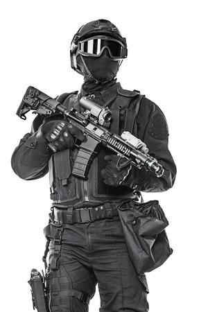 mask: Spec ops police officer SWAT in black uniform and face mask studio shot