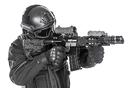 assault rifle: Spec ops police officer SWAT in black uniform and face mask studio shot