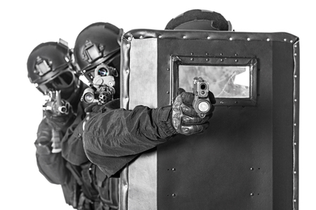 anti nato: Spec ops police officers SWAT with ballistic shield studio shot Stock Photo