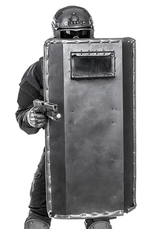 riot: Spec ops police officer SWAT with ballistic shield studio shot