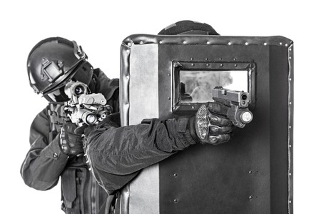 swat: Spec ops police officers SWAT with ballistic shield studio shot Stock Photo