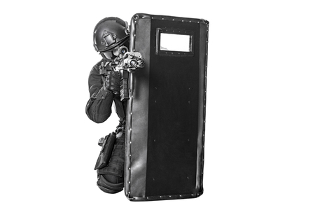 ballistic: Spec ops police officer SWAT with ballistic shield studio shot