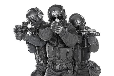 Spec ops police officers SWAT in black uniform and face mask studio shot Banque d'images