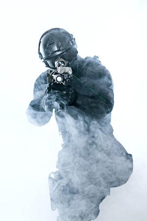 anti nato: police officer SWAT in black uniform and face mask studio shot