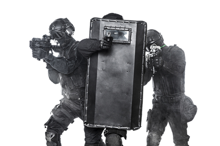 ballistic: Police officers SWAT with ballistic shield in the smoke studio shot