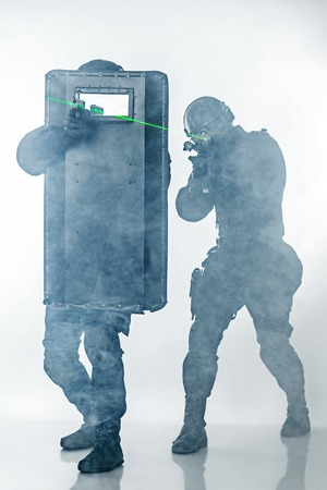 swat: Police officers SWAT with ballistic shield in the smoke studio shot