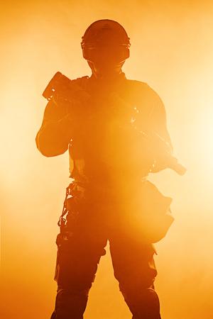 Police officer SWAT in black uniform in the smoke studio shot Stock Photo