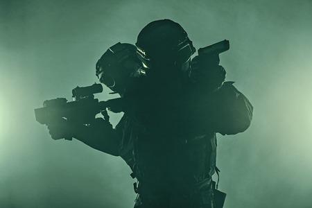 anti nato: Police officers SWAT in black uniform in the smoke studio shot