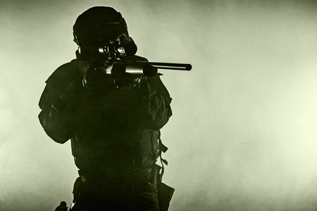 anti nato: Police officer SWAT in black uniform in the smoke studio shot Stock Photo