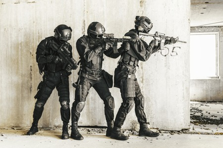 swat: Spec ops police officers SWAT in action Stock Photo