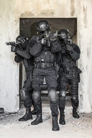 soldier with rifle: Spec ops police officers SWAT in action Stock Photo
