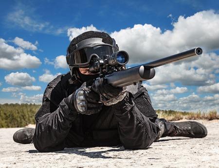 Police sniper SWAT in black uniform in action