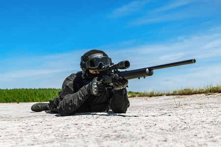 sniper rifle: Police sniper SWAT in black uniform in action
