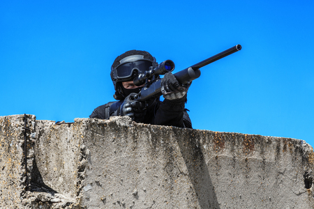 swat: Police sniper SWAT in black uniform in action