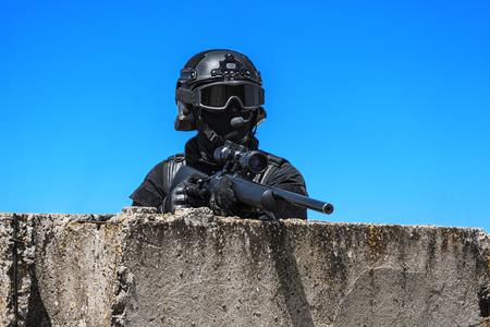 anti nato: Police sniper SWAT in black uniform in action