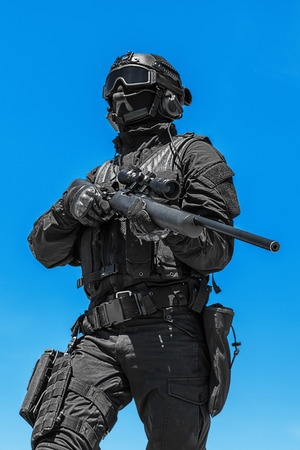 counter terrorism: Police sniper SWAT in black uniform in action