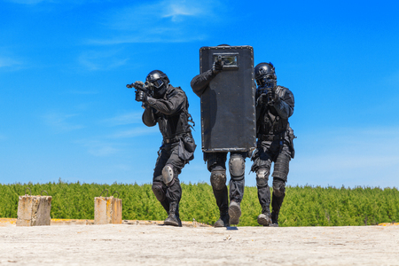 riot: Spec ops police officers SWAT with ballistic shield in action