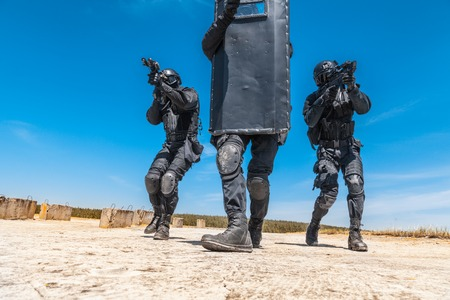 weapon: Spec ops police officers SWAT with ballistic shield in action
