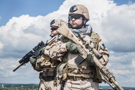 military forces: Navy SEALs Team with weapons in action