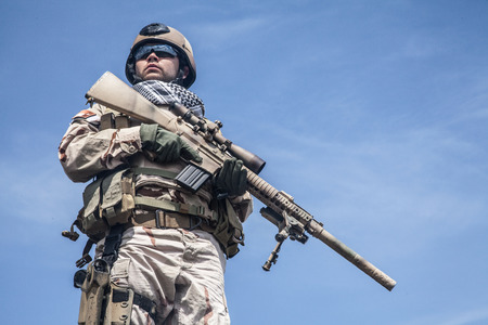 navy seal: Member of Navy SEAL Team with weapons in action Stock Photo