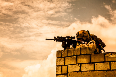 army soldier: Member of Navy SEAL Team with weapons in action Stock Photo