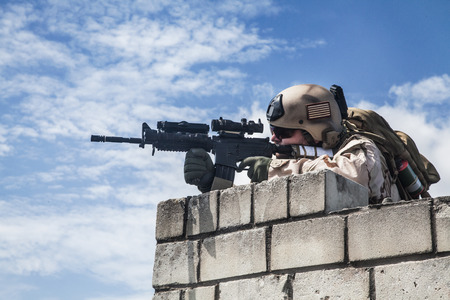 recon: Member of Navy SEAL Team with weapons in action Stock Photo
