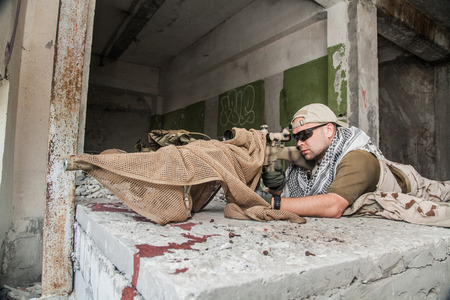marksman: Navy Seal Sniper with rifle in action Stock Photo