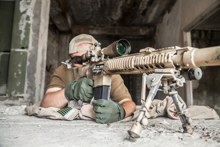 recon: Navy Seal Sniper with rifle in action Stock Photo