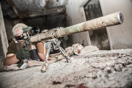 navy seal: Navy Seal Sniper with rifle in action Stock Photo