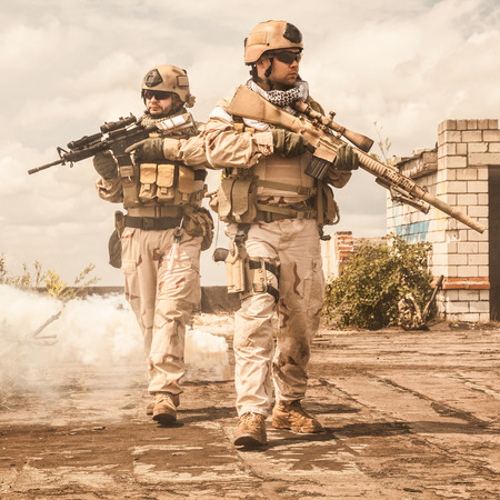 weapon: Navy SEALs Team with weapons in action