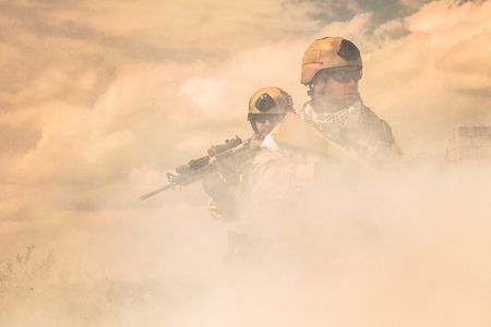 war: Navy SEALs Team with weapons in action