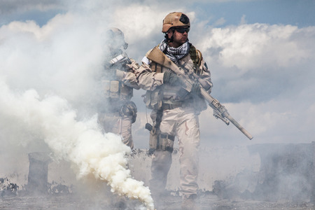 Navy SEALs Team with weapons in action