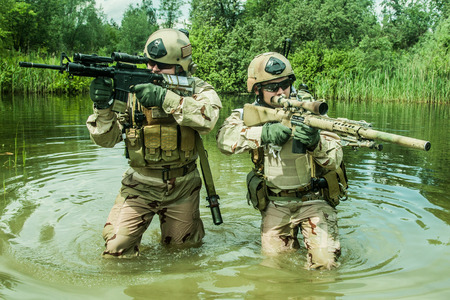 navy seal: Navy SEALs crossing the river with weapons